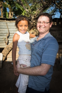 Doug with his sponsored child Evelyn.